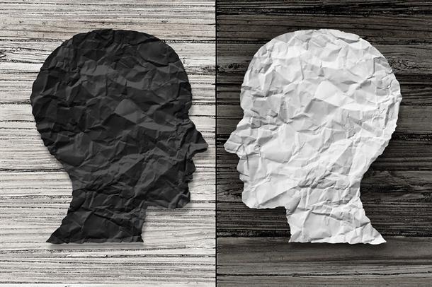 Illustrasjon av bipolar lidelse, ett hvitt og ett svart hode