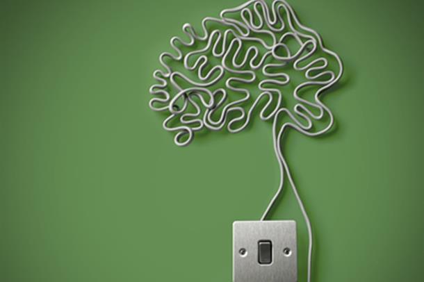 illustrasjonsfoto av en hjerne laget av tråd og tilkoblet lysbryter